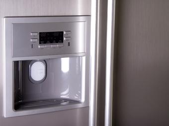 bigstockphoto_front_of_modern_refrigerator_5613814