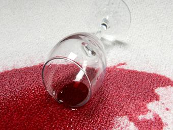 bigstockphoto_spilled_red_wine_on_carpet__3791338