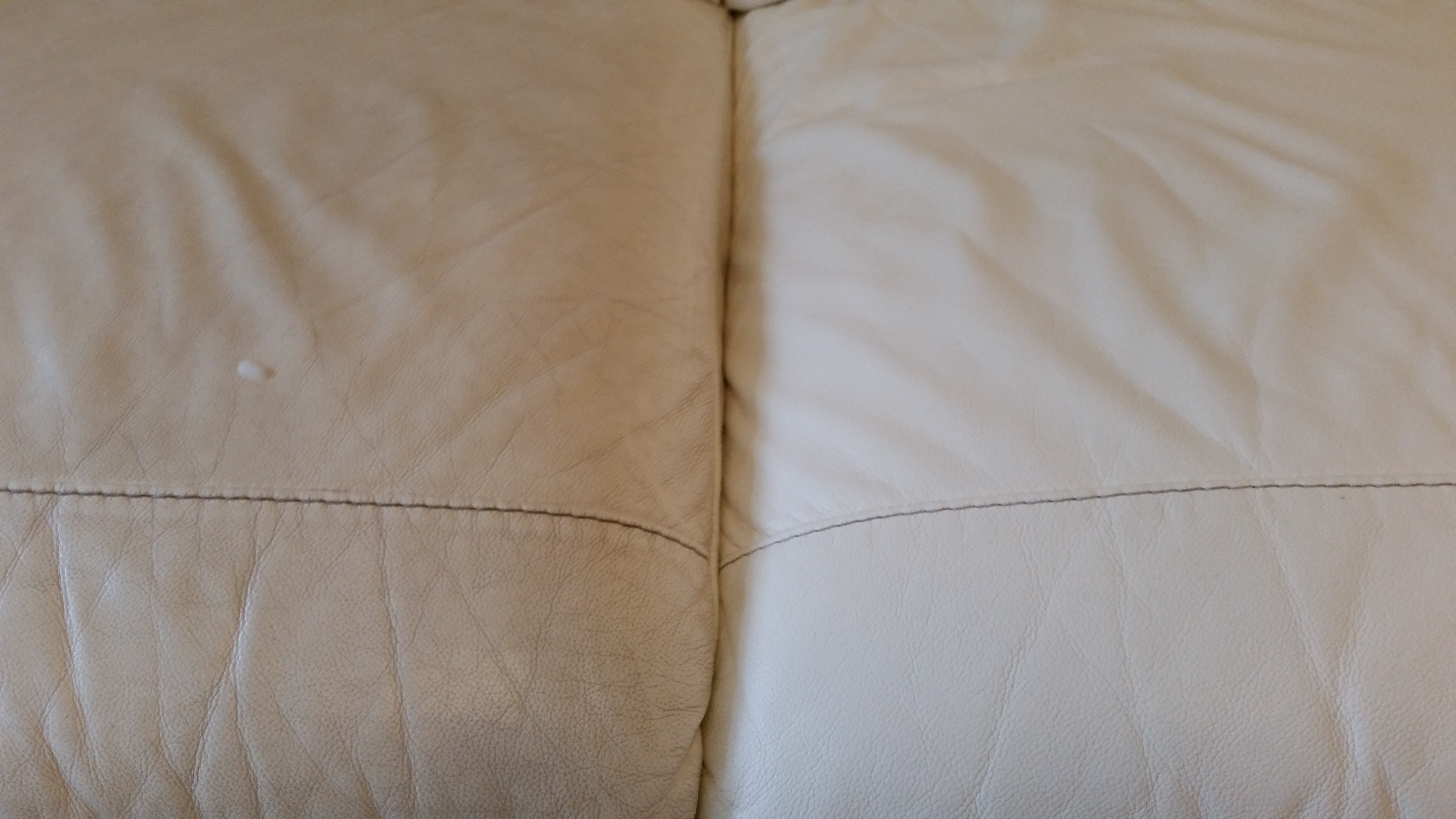 cream leather sofa one side clean close up